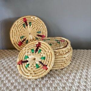 Multicoloured woven coasters in case